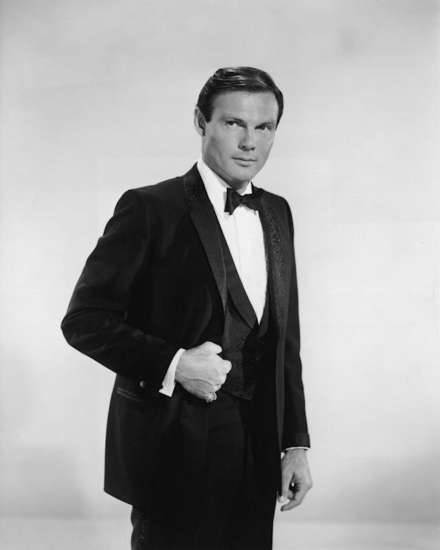 "<p>Promotional studio portrait of Adam West, from the television series ""Batman"" standing with his thumb in the vest pocket of his tuxedo, circa 1966. (Photo: Hulton Archive/Getty Images) </p>"