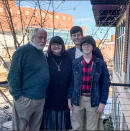 In this 2019 photo released by Shelley Summer, Greenville resident John Wickersham, left, father of Shelley Summer, center, with her two sons Briggs Summer and Davis Summer at the Lazy Goat in downtown Greenville, S.C. Shelley Summer says she and her 75 year old father struggled to get him a COVID-19 vaccination appointment, navigating complicated online scheduling systems. (Shelley Summer via AP)