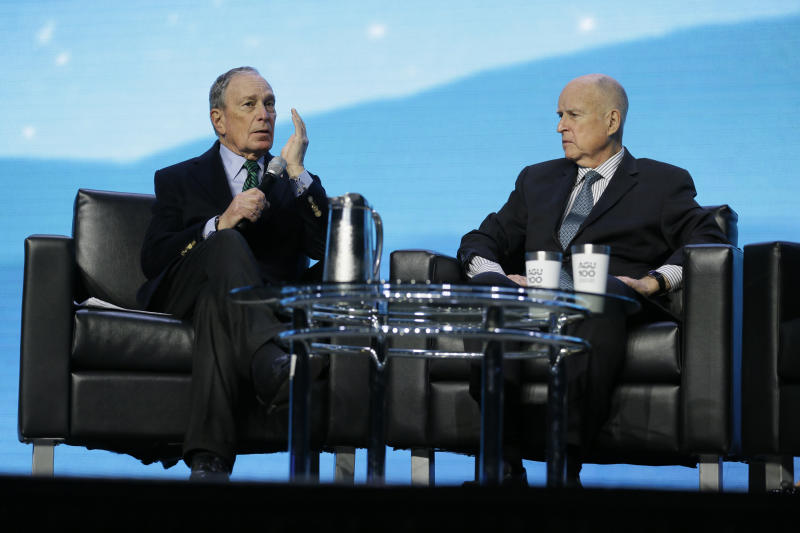 Democratic Presidential candidate Michael Bloomberg, left, takes part in an on-stage conversation with former California Gov. Jerry Brown at the American Geophysical Union fall meeting Wednesday, Dec. 11, 2019, in San Francisco. Bloomberg made his first visit to California as a Democratic presidential candidate, appearing earlier with the mayor of Stockton who's championed universal basic income. Bloomberg and Brown talked about America's Pledge, bringing together leaders to ensure the U.S. remains a global leader in reducing emissions and delivering the goals of the Paris Agreement. (AP Photo/Eric Risberg)
