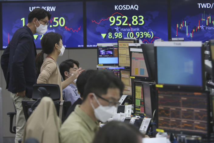 Currency traders watch monitors at the foreign exchange dealing room of the KEB Hana Bank headquarters in Seoul, South Korea, Tuesday, May 4, 2021. Asian shares were mixed Tuesday after strong corporate earnings and economic data lifted stocks on Wall Street. (AP Photo/Ahn Young-joon)