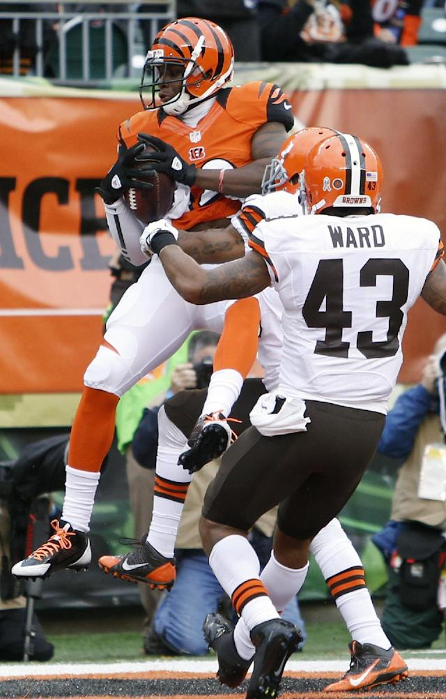 Cincinnati Bengals wide receiver Mohamed Sanu catches a six-yard touchdown pass against the Cleveland Browns in the first half of an NFL football game, Sunday, Nov. 17, 2013, in Cincinnati. Strong safety T.J. Ward (43) pursues. (AP Photo/David Kohl)