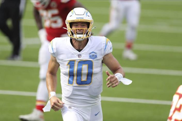 Los Angeles Chargers quarterback Justin Herbert (10) celebrates after his first career NFL touchdown pass.