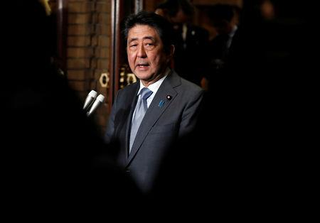 FILE PHOTO:  Japan's Prime Minister Shinzo Abe speaks to media after phone talks with U.S. President Donald Trump after second North Korea-U.S. summit, in Tokyo