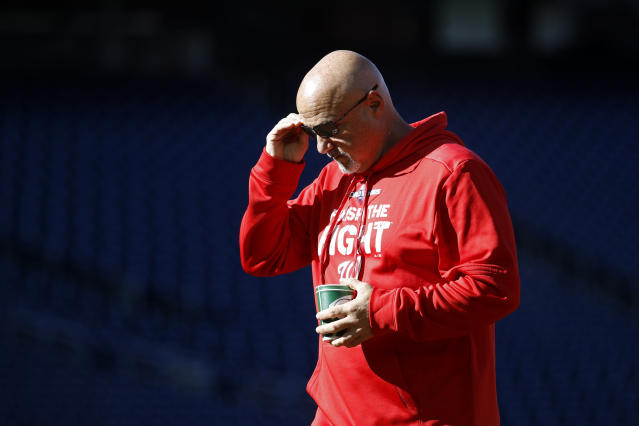 Washington Nationals general manager Mike Rizzo walks on the field during a baseball workout, Friday, Oct. 18, 2019, in Washington, in advance of the team's appearance in the World Series. (AP Photo/Patrick Semansky)