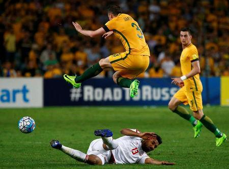Football Soccer - Australia vs United Arab Emirates - 2018 World Cup Qualifying Asian Zone - Group B - Sydney Football Stadium, Sydney, Australia - 28/3/17 - Australia's Brad Smith is challenged by UAE's Khamis Esmaeel. REUTERS/David Gray