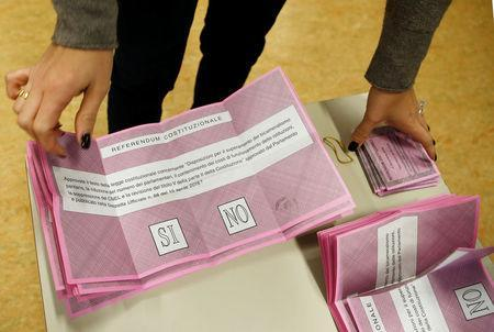 Referendum ballots are seen at a polling station in Milan, Italy, December 4, 2016. REUTERS/Alessandro Garofalo