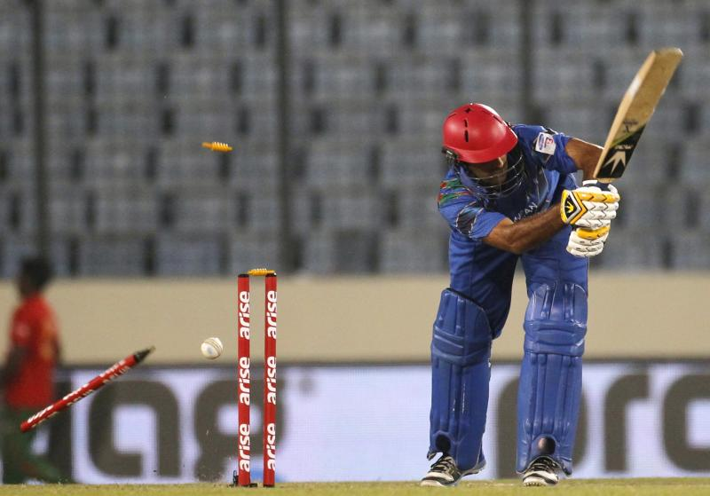 Afghanistan's Asghar Stanikzai is bowled out against Sri Lanka during their one-day international (ODI) cricket match in Asia Cup 2014 in Dhaka.