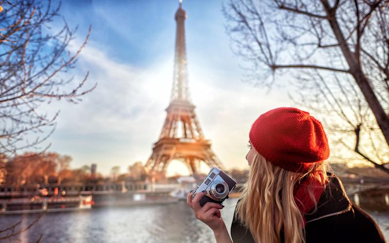 Tourists warned to be vigilant at all times when exploring Paris - stock_colors