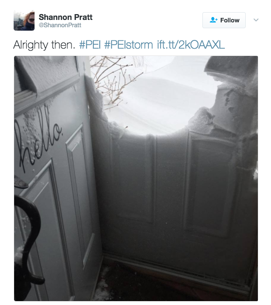 <p>Accumulated snow blocks the doorway to a home in P.E.I. during the massive snowstorm. Photo from Twitter </p>