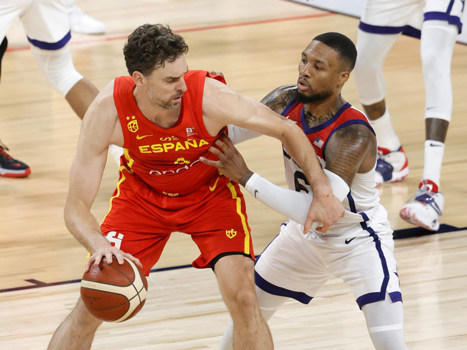 LAS VEGAS, NEVADA - JULY 18:  Pau Gasol #4 of Spain is guarded by Damian Lillard #6 of the United States during an exhibition game at Michelob ULTRA Arena ahead of the Tokyo Olympic Games on July 18, 2021 in Las Vegas, Nevada. The United States defeated Spain 83-76.  (Photo by Ethan Miller/Getty Images)