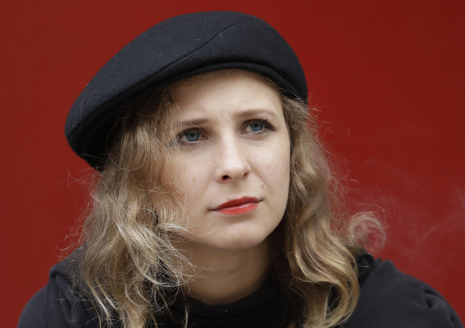 FILE- In this Oct. 13, 2017, Maria Alekhina, member of Russian punk collective Pussy Riot, poses for a portrait at La Mama Theater in New York. A Moscow court on Friday considered a request to put several allies of Russian opposition leader Alexei Navalny under house arrest, including Alekhina, as authorities work to stymie more protests over the jailing of the anti-corruption investigator. (AP Photo/Mark Lennihan, File)