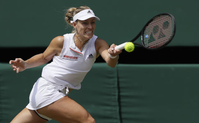 Germany's Angelique Kerber returns the ball to Latvia's Jelena Ostapenko during their women's singles semifinals match at the Wimbledon Tennis Championships, in London, Thursday July 12, 2018. (AP Photo/Kirsty Wigglesworth)