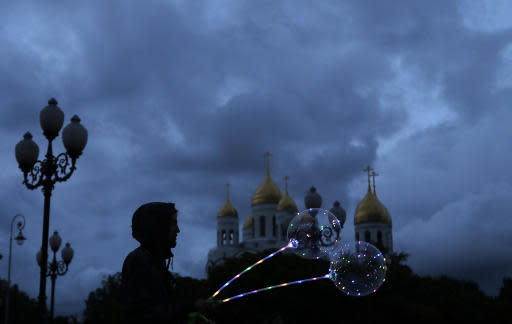 A vendor sells balloons as he waits for customers during the 2018 soccer World Cup downtown Kaliningrad, Russia, Sunday, June 24, 2018. (AP Photo/Manu Fernandez)