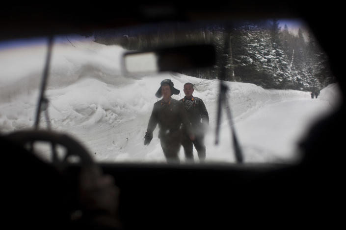 In this Monday, April 2, 2012 photo, North Korean soldiers walk on a snowy mountain road at the base of Mount Paektu, North Korea near a secret camp that is said to have been the home of the late North Korean leader Kim Il Sung and the birthplace of his son and late leader Kim Jong Il. (AP Photo/David Guttenfelder)