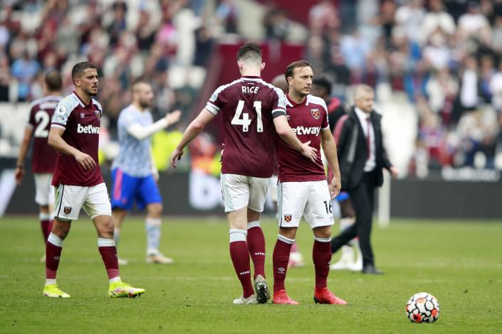West Ham's Declan Rice, left, and Mark Noble react after the English Premier League soccer match between West Ham United and Manchester United at the London Stadium in London, England, Sunday, Sept. 19, 2021. Manchester United won 2-1. (AP Photo/Ian Walton)
