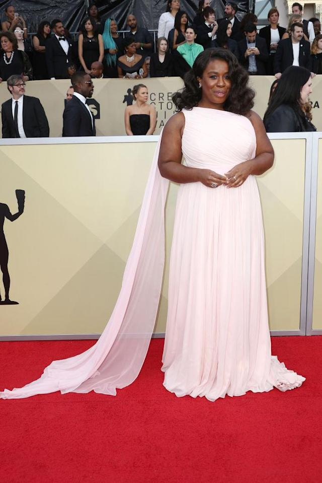 <p>The <em>OITNB</em> star wore a gorgeous pink dress with a shoulder train. (Photo: Getty Images) </p>