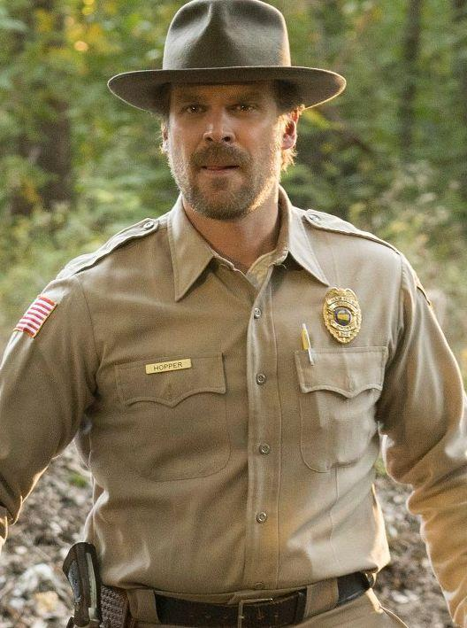 """<a href=""""http://www.spirithalloween.com/product/adult-jim-hopper-costume-stranger-things/153803.uts"""" target=""""_blank"""">Get the look</a>."""