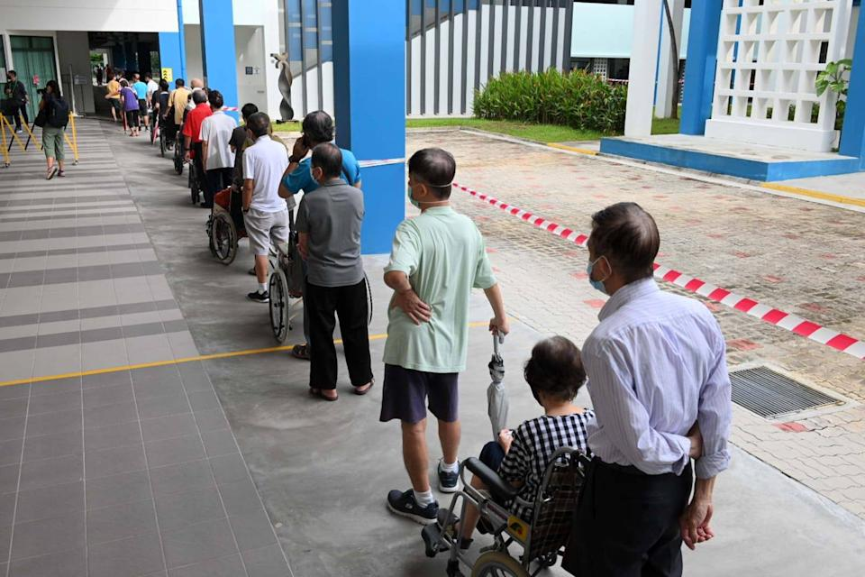 Voters queueing up to vote at Dunearn Secondary School, during the 2020 General Election in Singapore. (Photo: Dhany Osman / Yahoo News Singapore)