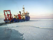 In this Nov. 14, 2019 photo provided by John Guillote and taken from an aerial drone shows the research vessel Sikuliaq as it makes its way through thin sea ice in the Beaufort Sea off Alaska's north coast. University of Washington scientists onboard the research vessel are studying the changes and how less sea ice will affect coastlines, which already are vulnerable to erosion because increased waves delivered by storms. More erosion would increase the chance of winter flooding in villages and danger to hunters in small boats. (John Guillote via AP)