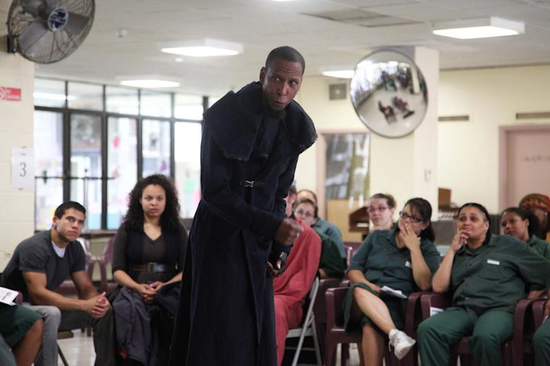 This Monday, July 30, 2012 photo shows actor Ron Cephas Jones playing Richard III in a performance of the Shakespeare play at the Taconic Correctional Facility in Bedford Hills, N.Y. The Public Theater's stripped down production, performed by a nine-member cast that play some 20 roles, has made more than 15 stops across the city, from a recreation center on Staten Island to a facility for homeless adults with mental illness in Manhattan. (AP Photo/Mark Kennedy)