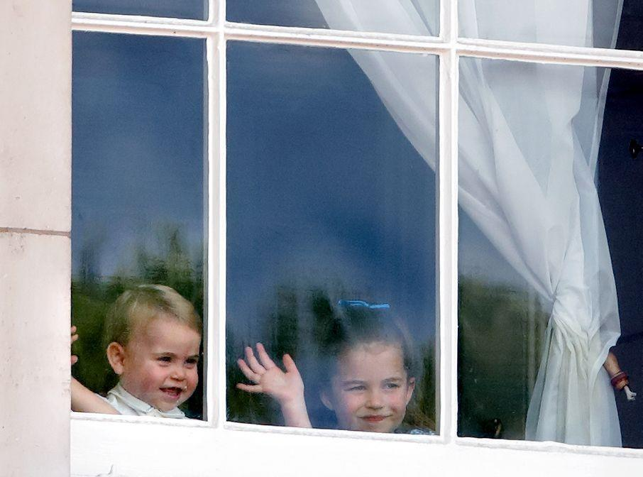 <p>Prince Louis and Princess Charlotte wave from a window of Buckingham Palace during Trooping of the Colour.</p>
