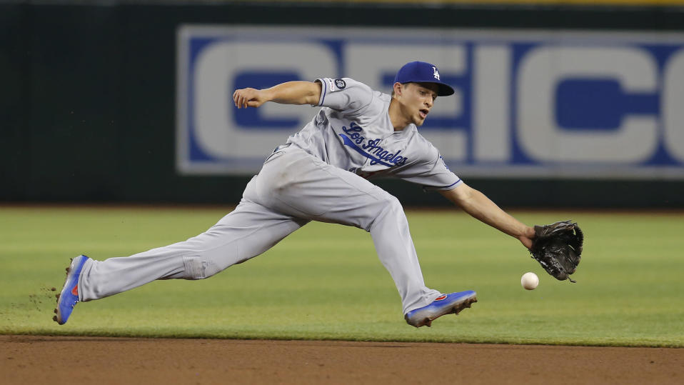 Los Angeles Dodgers shortstop Corey Seager reaches for the ball on a single hit by Arizona Diamondbacks' Jarrod Dyson in the fourth inning during a baseball game, Wednesday, June 5, 2019, in Phoenix. (AP Photo/Rick Scuteri)