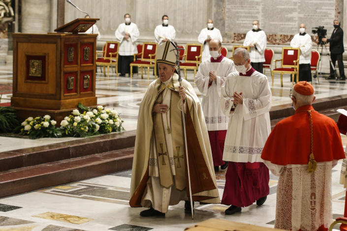 Pope Francis leaves at the end of a consistory ceremony where 13 bishops were elevated to a cardinal's rank in St. Peter's Basilica at the Vatican, Saturday, Nov. 28, 2020. (Fabio Frustaci/POOL via AP)
