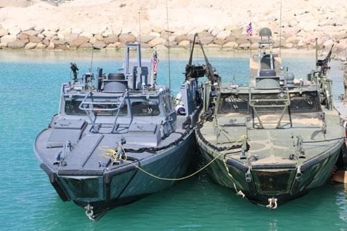 A picture released on January 13, 2016, shows US patrol boats in custody at the Farsi Island after they entered Iranian waters unintentionally (AFP Photo/)