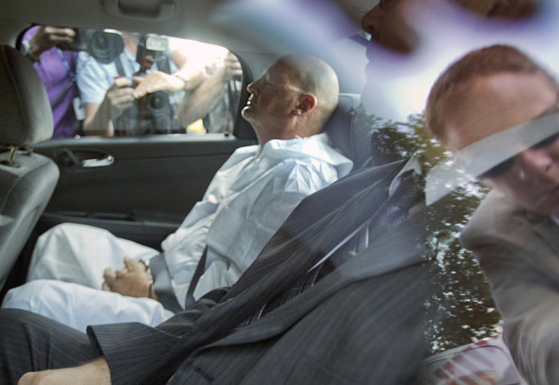 Richard Henry Bain arrives at court in Montreal on Thursday, Sept.6, 2012. Bain, 61, the suspect in a deadly shooting at a rally following the election of Quebec's new separatist premier was arraigned Thursday on 16 charges, including murder, attempted murder and possession of explosives. (AP Photo/Le Devoir via The Canadian Press, Jacques Nadeau) MONTREAL OUT