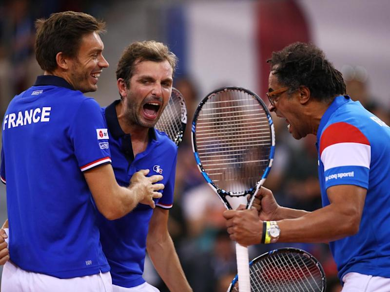 The trio embraced one another as they won a point against Evans (Getty)