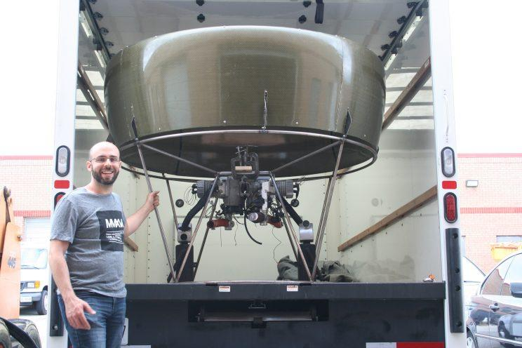 Talek Ibrahim stands next to the prototype of his Airvinci personal helicopter. (supplied)