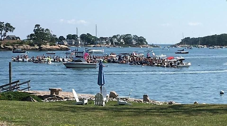 A photo provided via The Office of Governor Ned Lamont shows a party on boats in Stony Creek, Conn., that Gov. Ned Lamont said illustrated a growing problem with parties among teenagers and young adults. (via The Office of Governor Ned Lamont via The New