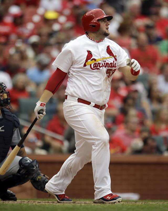St. Louis Cardinals' Matt Adams watches his two-run home run during the fifth inning of a baseball game against the Seattle Mariners Sunday, Sept. 15, 2013, in St. Louis. (AP Photo/Jeff Roberson)