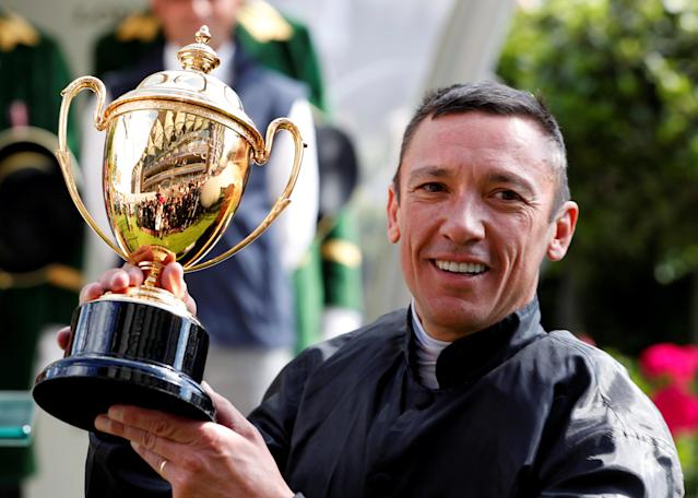 Horse Racing - Royal Ascot - Ascot Racecourse, Ascot, Britain - June 21, 2018 Frankie Dettori celebrates with the trophy after winning the 4.20 Gold Cup riding Stradivarius Action Images via Reuters/Paul Childs