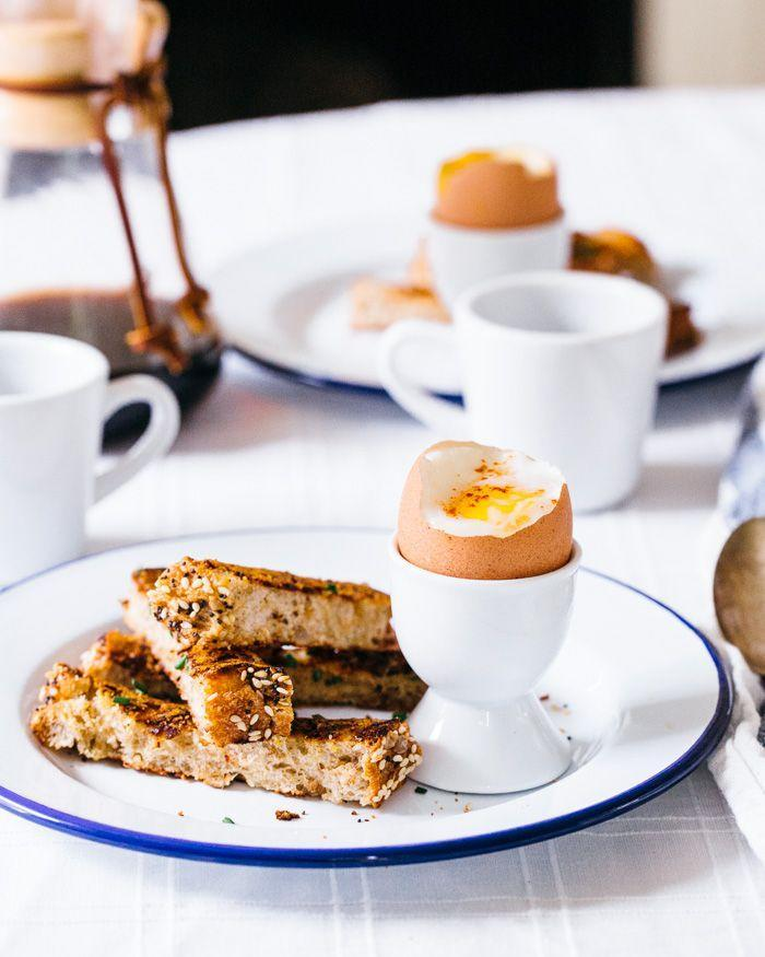 """<p>Make some cheesy toast to dip into your soft boiled egg. It's a game-changer.</p><p><a href=""""http://www.acouplecooks.com/2015/05/dippy-eggs-with-cheese-fried-toast-soldiers/"""" rel=""""nofollow noopener"""" target=""""_blank"""" data-ylk=""""slk:Get the recipe from A Couple Cooks »"""" class=""""link rapid-noclick-resp""""><em>Get the recipe from A Couple Cooks »</em></a><br></p>"""