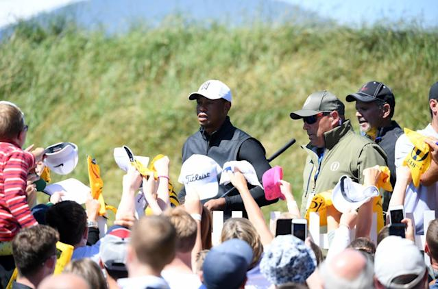 """<h1 class=""""title"""">148th Open Championship - Previews</h1> <div class=""""caption""""> PORTRUSH, NORTHERN IRELAND - JULY 14: Fans seek autographs from Tiger Woods of the United States during a practice round prior to the 148th Open Championship held on the Dunluce Links at Royal Portrush Golf Club on July 14, 2019 in Portrush, United Kingdom. (Photo by Jan Kruger/R&A/R&A via Getty Images) </div> <cite class=""""credit"""">Jan Kruger/R&A</cite>"""