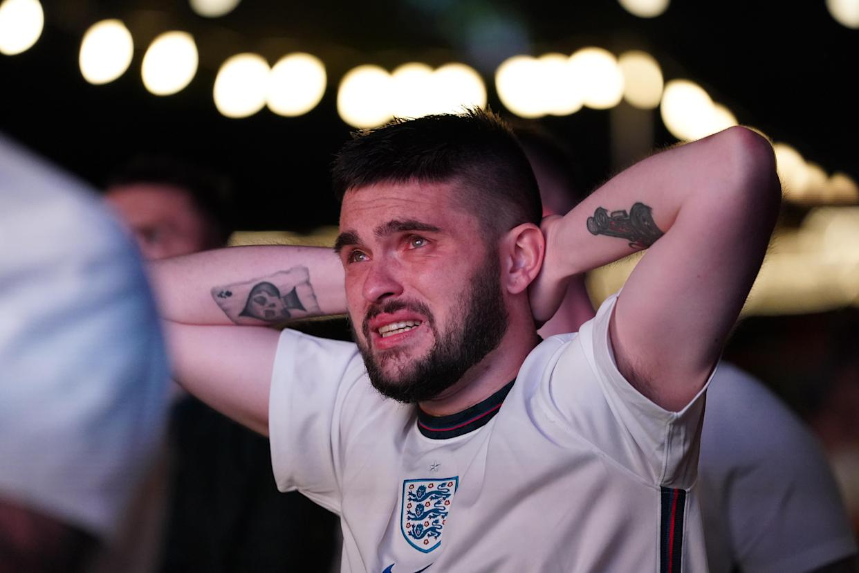 An England fan in tears at Luna Springs in Birmingham watching the UEFA Euro 2020 Final between Italy and England. Picture date: Sunday July 11, 2021.
