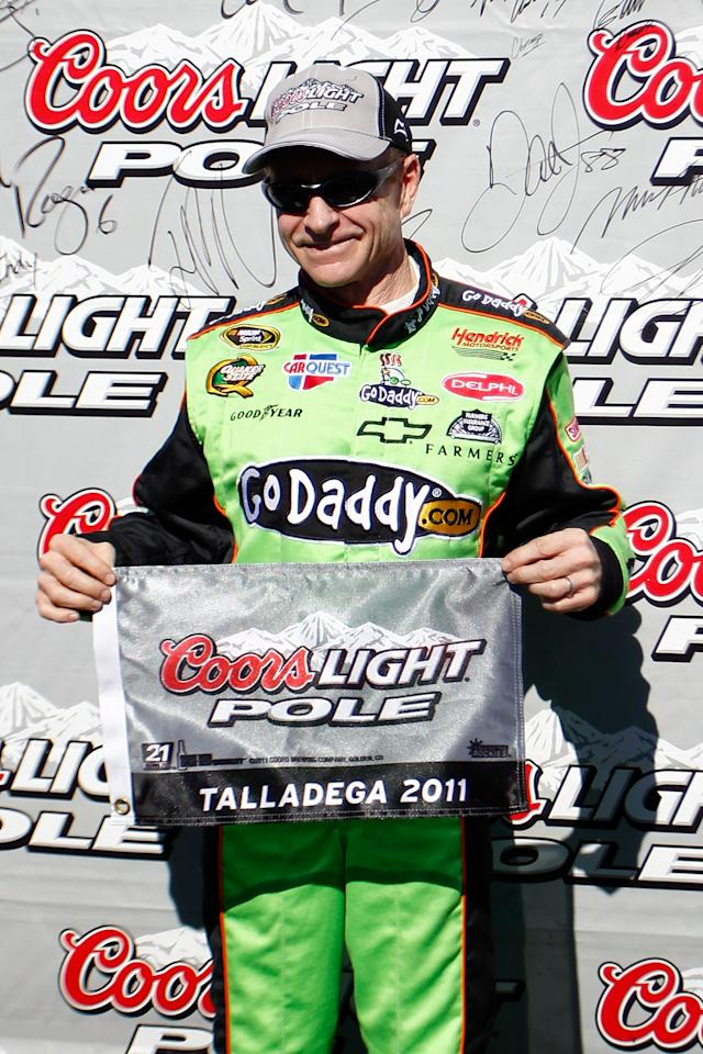 TALLADEGA, AL - OCTOBER 22:  Mark Martin, driver of the #5 GoDaddy.com Chevrolet, celebrates setting the pole position in qualifying for the NASCAR Sprint Cup Series Good Sam Club 500 at Talladega Superspeedway on October 22, 2011 in Talladega, Alabama.  (Photo by Jeff Zelevansky/Getty Images for NASCAR)