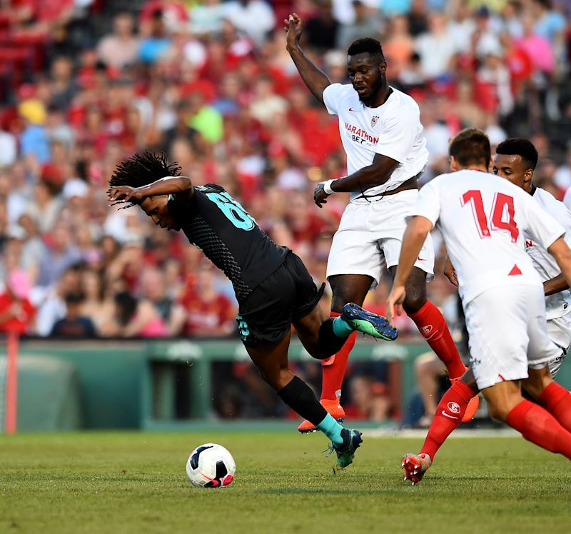 BOSTON, MASSACHUSETTS - JULY 21: (THE SUN OUT, THE SUN ON SUNDAY OUT) Yasser Larouci of Liverpool brought down by Gnagnon Joris Sevilla during a Pre-Season Friendly match between Sevilla and Liverpool at Fenway Park on July 21, 2019 in Boston, Massachusetts. (Photo by Andrew Powell/Liverpool FC via Getty Images)