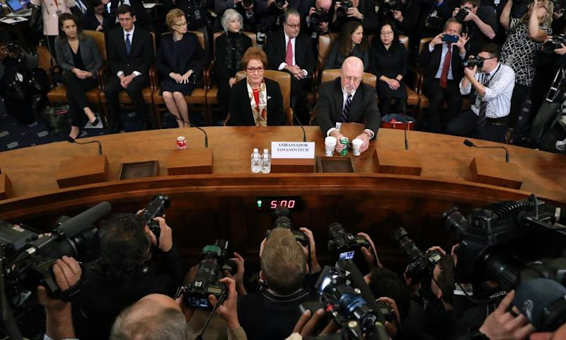 Marie Yovanovitch, right, sits next to her attorney, Larry Robbins, before testifying on Capitol Hill in Washington DC, on 15 November.