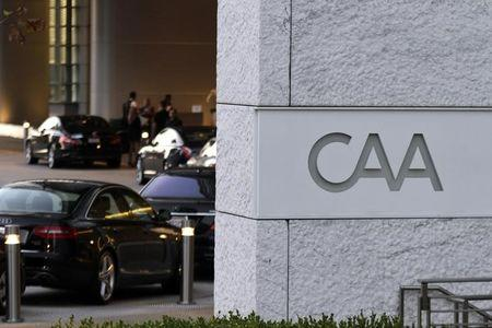 Cars are shown lined up at the valet parking area outside the Creative Artists Agency building in Los Angeles