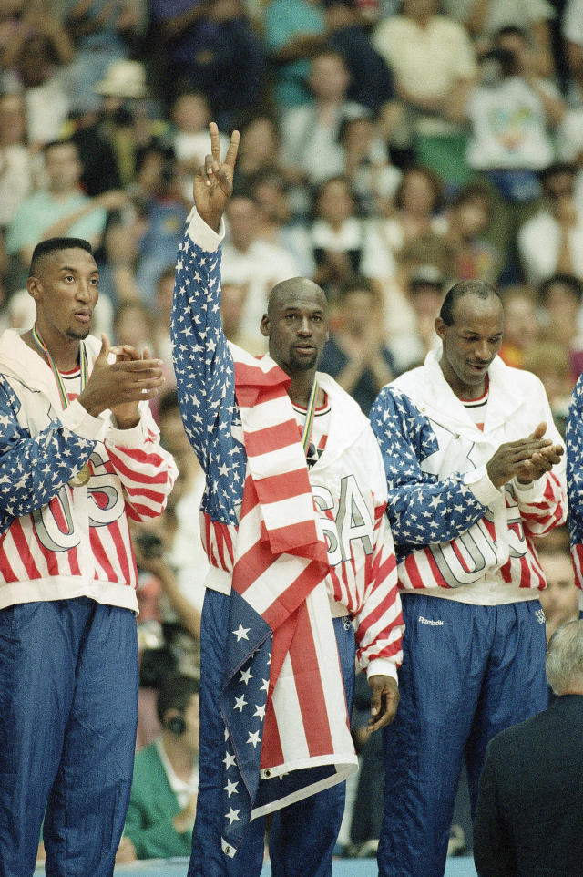 The USA's Scottie Pippen, left, Michael Jorden, center, and Clyde Drexler rejoice with their gold medals after beating Croatia, 117-85 in Olympic basketball in Barcelona Saturday, August 8, 1992. (AP Photo/Susan Ragan)