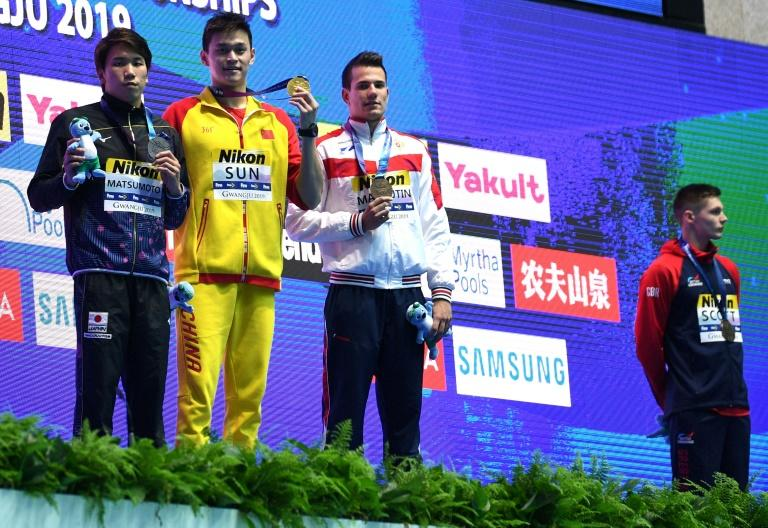 FINA has warned China's Sun Yang and British rival Duncan Scott (right)
