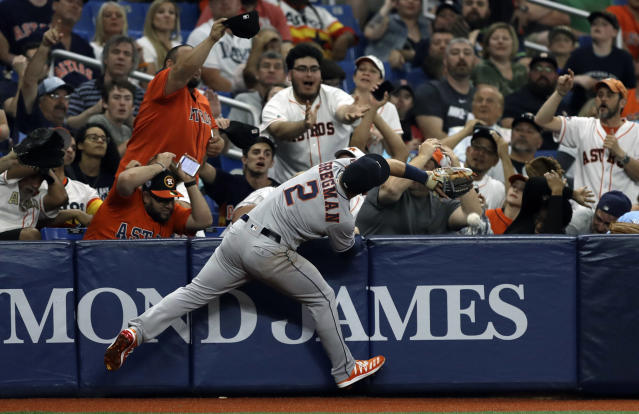 Houston Astros third baseman Alex Bregman (2) can't get to a pop up by Tampa Bay Rays' Mike Zunino during the fifth inning of a baseball game Friday, March 29, 2019, in St. Petersburg, Fla. (AP Photo/Chris O'Meara)