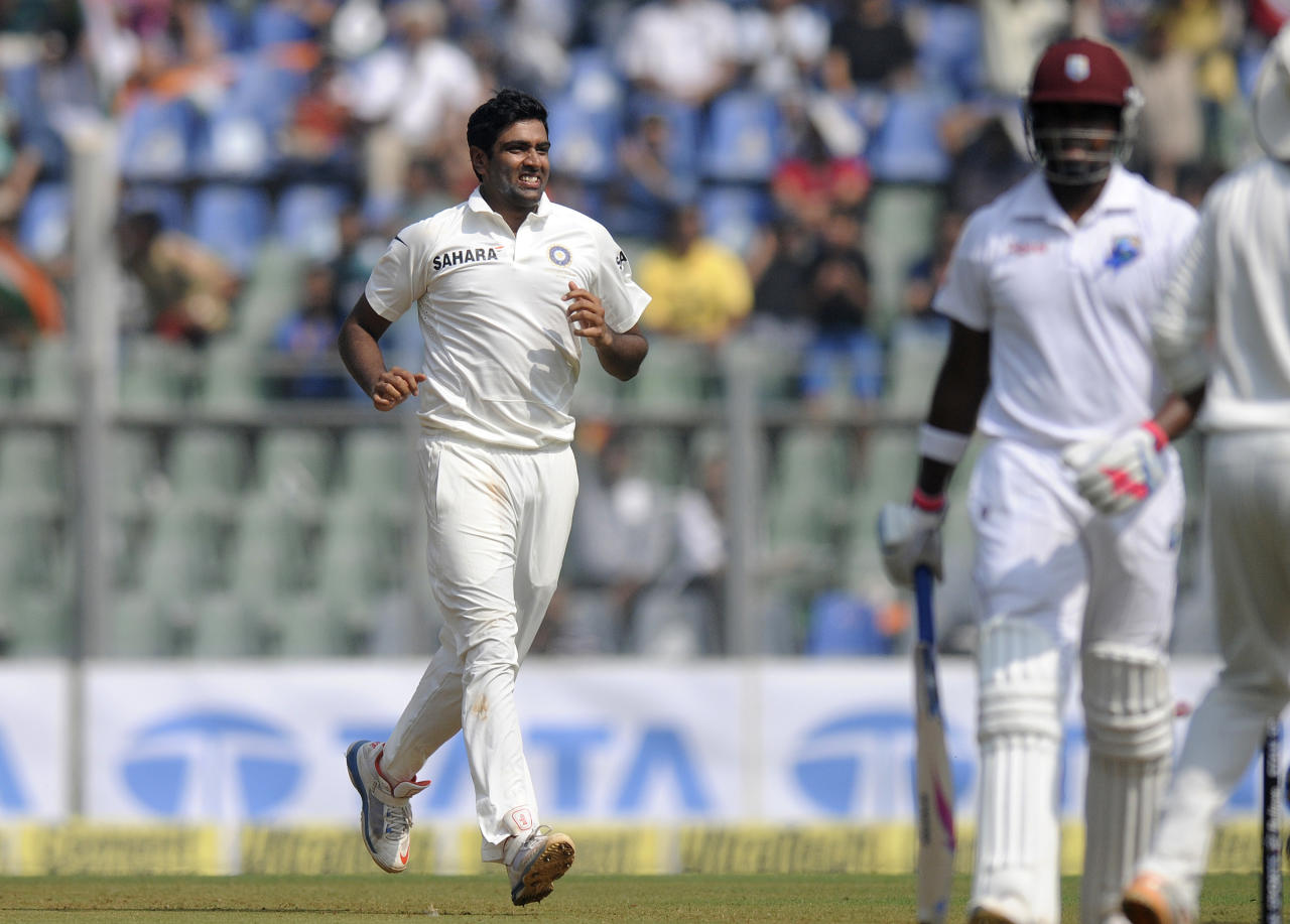 Ravichandran AShwin of India runs to celebrate the wicket of Darren Bravo of West Indies during day one of the second Star Sports test match between India and The West Indies held at The Wankhede Stadium in Mumbai, India on the 14th November 2013  This test match is the 200th test match for Sachin Tendulkar and his last for India.  After a career spanning more than 24yrs Sachin is retiring from cricket and this test match is his last appearance on the field of play.  Photo by: Pal PIllai - BCCI - SPORTZPICS  Use of this image is subject to the terms and conditions as outlined by the BCCI. These terms can be found by following this link:  https://ec.yimg.com/ec?url=http%3a%2f%2fsportzpics.photoshelter.com%2fgallery%2fBCCI-Image-Terms%2fG0000ahUVIIEBQ84%2fC0000whs75.ajndY&t=1490363988&sig=lYFhBmPLx.FPtUZ8qI1Z3w--~C