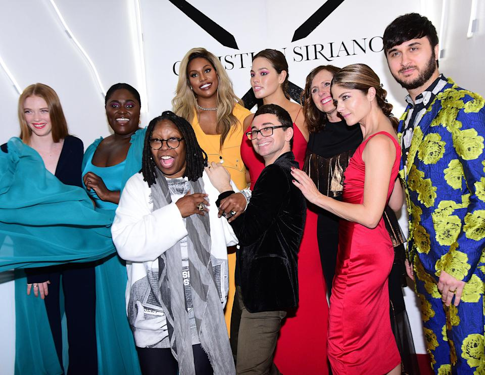 Christian Siriano (center) is surrounded by collaborators and fans, including (from left) Larsen Thompson, Danielle Brooks, Whoopi Goldberg, Laverne Cox, Ashley Graham, Molly Shannon, Selma Blair, and Brad Walsh. (Photo: Getty Images)
