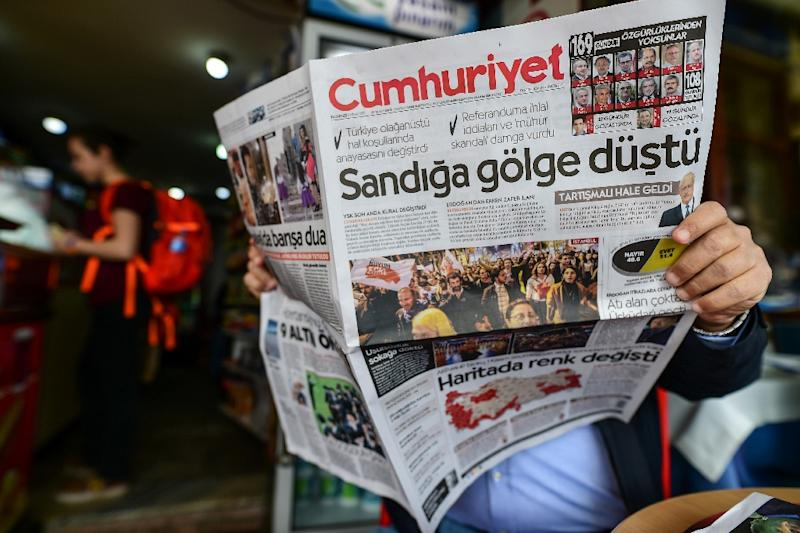 """In Turkey after the referendum, opposition newspaper Cumhuriyet ran a headline focused on alleged vote violations: """"A shadow fell over the ballot boxes"""" (AFP Photo/YASIN AKGUL)"""