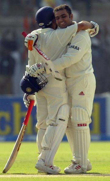 MULTAN, PAKISTAN - MARCH 28:  Virender Sehwag (R) of India is hugged by Sachin Tendulkar after Sehwag reached his 200 during day 1 of the 1st Test Match between Pakistan and India at Multan Stadium on March 28, 2004 in Multan, Pakistan. (Photo by Scott Barbour/Getty Images)