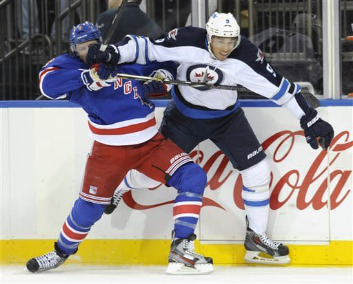 New York Rangers' Darroll Powe, left, runs into Winnipeg Jets' Evander Kane during the first period of an NHL hockey game Monday, April 1, 2013, at Madison Square Garden in New York. (AP Photo/Bill Kostroun)