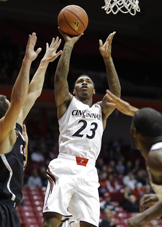 Cincinnati guard Sean Kilpatrick (23) shoots against Carleton in the first half of an NCAA exhibition college basketball game, Saturday, Oct. 26, 2013, in Cincinnati. (AP Photo/Al Behrman)